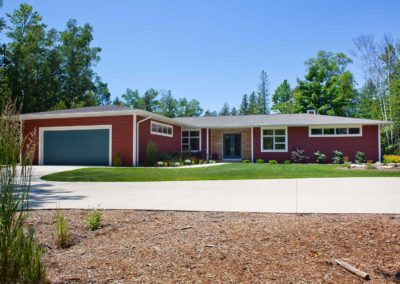 Custom-built mid-century modern style waterfront home on waterfront property in Door County.