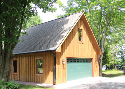 Cute detached garage in Baileys Harbor with cabin look.