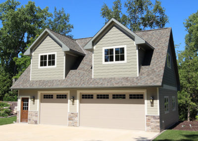 3 stall garage with bonus room with dormers, built by PortSide Builders.