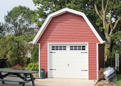 Red detached garage or shed