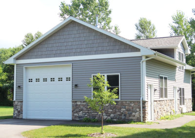 Single stall garage with additional storage and living space above. Built by Portside Builders in Door County, WI